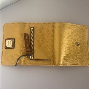 Dooney & Bourke Bags - Dooney & Bourke Small leather Flap Wallet yellow